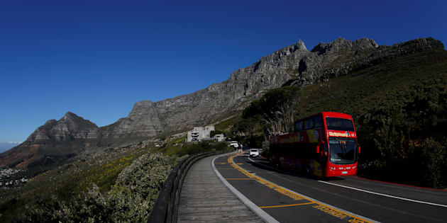 A tour bus carries visitors to Table Mountain in Cape Town, South Africa, August 5, 2017. REUTERS/Mike Hutchings