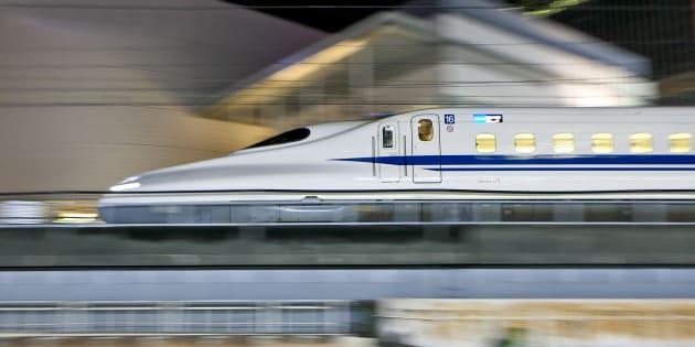 Tokyo, Japan - September 4, 2014: N700 series Shinkansen bullet train approaches Tokyo Station in the night.