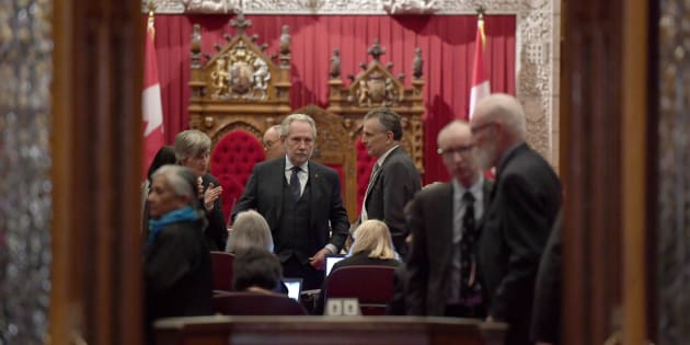 Sen. Peter Harder, government representative in the Senate, left, speaks with Sen. Larry Smith, leader of the opposition in the Senate, before a vote on Bill C-45, the Cannabis Act, in the Senate chamber on Parliament Hill in Ottawa on Thursday.