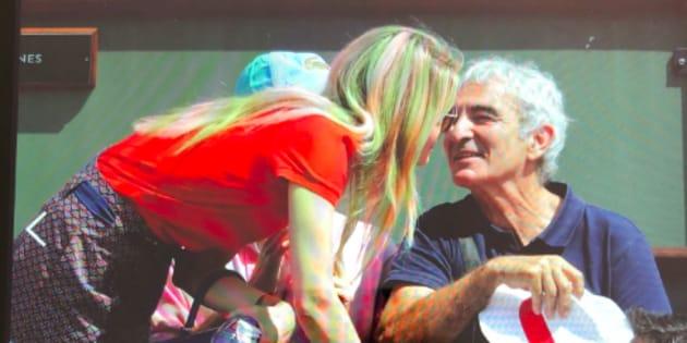 Raymond Domenech en compagnie de Carine Galli à Roland-Garros.