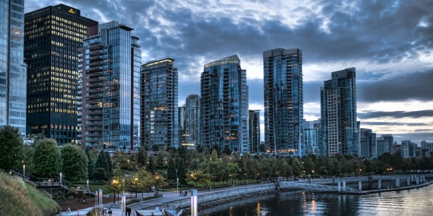 Condo towers overlooking Coal Harbour in Vancouver, Oct. 1, 2014. The condominium market has turned red-hot in Vancouver, with agents saying local and offshore buyers are snapping up units that are not yet completed, even as a foreign buyer tax has sent detached home sales plunging.
