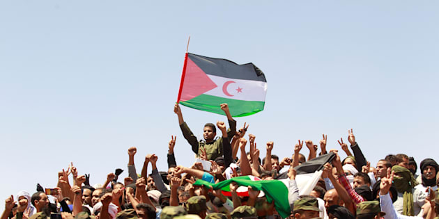 Indigenous Sahrawi people react during the funeral of Western Sahara's Polisario Front leader Mohamed Abdelaziz in Tindouf, Algeria June 3, 2016.