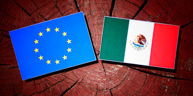 EU flag with Mexican flag on a tree stump isolated