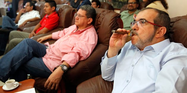 HAVANA, CUBA - OCTOBER 02: Rodrigo Londoño Echeverri, also known as Timochenko and Timoleón Jimenez, the top leader of the Revolutionary Armed Forces of Colombia, FARC, smokes a cuban cigar while waits for the final count of votes of the plebiscite held in Colombia on October 02, 2016 in Havana, Cuba. (Photo by Ernesto Mastrascusa/LatinContent/Getty Images)