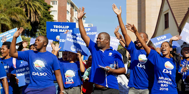 South African main opposition party Democratic Alliance supporters of mayoral candidate for Nelson Mandela Bay municipality, Athol Trollip (not in picture), cheer during a rally outside the Mayor's office on April 14, 2016 in Port Elizabeth.