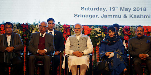 India's Prime Minister Narendra Modi (C), Jammu and Kashmir Chief Minister Mehbooba Mufti (2nd R) attend the inauguration of a hydroelectric power plant in the state of Jammu and Kashmir, at Sher-i-Kashmir International Conference Centre (SKICC) in Srinagar, May 19, 2018. REUTERS/Danish Ismail