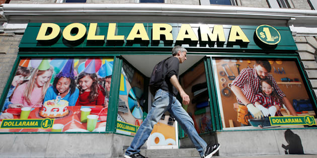 A pedestrian walks past a Dollarama store in Ottawa, Ont., Sept. 1, 2016. Shares of the retail giant hit record highs Thursday as the company announced an 11.5-per-cent jump in sales.