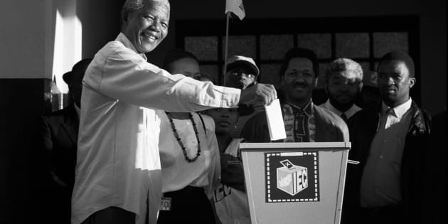 Nelson Mandela casts his historic vote in a small voting station on April 27, 1994 at Oshlange High School outside Durban.