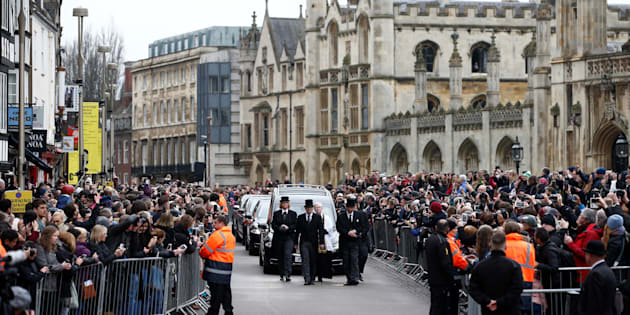 The funeral cortege arrives at Great St. Marys' Church, where the funeral of theoretical physicist Stephen Hawking is being held, in Cambridge, Britain on March 31, 2018.