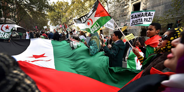 Activists for the independence of the Western Sahara wave flags and banners reading 'Sahara: Only Pace!' during an annual protest organised by the state coordinator of associations of solidarity with the Sahara in Madrid on November 11, 2016 marking the 4th anniversary of the tripartite Madrid agreements demonstrators deem illegal.  The Western Sahara is a territory bordered by Morocco and Algeria and disputed by Spain and Morocco who both claiming sovereignty.