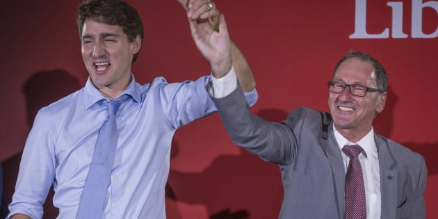 Richard Hebert, Liberal candidate for the byelection in the Lac-Saint-Jean riding, cheers with Prime Minister Justin Trudeau during a rally in Dolbeau-Mistassini, Que, on Oct. 19, 2017.