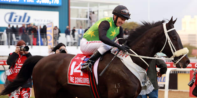 Jockey Pierre Strydom riding The Conglomerate smiles after winning the Durban July horse race on July 2, 2016, in Durban.  The Durban July is the biggest horse racing event on the African continent and attracts close to 55,000 spectators. Bets are placed in excess of an estimated R200 million.