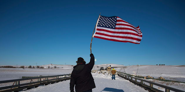 Dakota Access Pipeline protesters celebrate as they march back to the Oceti Sakowin campground after they found out the Army Corps of Engineers denied the easement to drill under Lake Oahe on Sunday, Dec. 4, 2016.