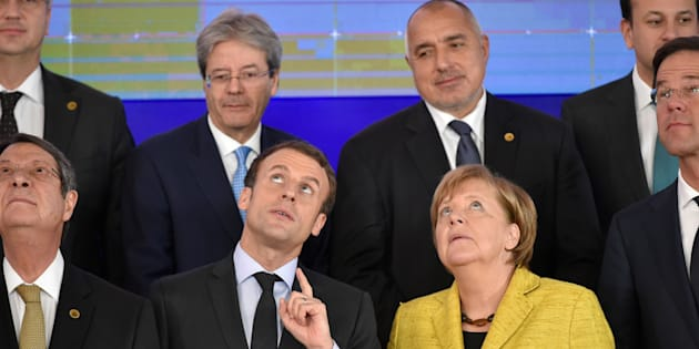 (second row) Italy's Prime minister Paolo Gentiloni (L), Bulgaria's Prime Minister Boyko Borisov , (first row LtoR) Cyprus President of Republic Nicos Anastasiades, French President of Republic Emmanuel Macron, German Chancellor Angela Merkel and Dutch Prime minister Mark Rutte take part in a family photo after the Reinforcing European Defence meeting on the first day of a European union summit in Brussels at the EU headquarters on December 14, 2017. European leaders will discuss the migration crisis and defence on December 14, followed by Brexit the day after. / AFP PHOTO / JOHN THYS        (Photo credit should read JOHN THYS/AFP/Getty Images)