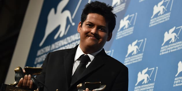 Writer and director Chaitanya Tamhane poses with the Orizzonti Award for Best Film and the Lion of the Future for a debut film (Luigi De Laurentis) for his movie 'Court' during a photocall following the awards ceremony on the closing day of the 71st Venice Film Festival on September 6, 2014 at Venice Lido.   AFP PHOTO / GABRIEL BOUYS        (Photo credit should read GABRIEL BOUYS/AFP/Getty Images)