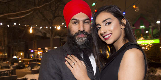 NDP Leader Jagmeet Singh poses with Gurkiran Kaur after proposing to her at an engagement party in Toronto on Jan. 16, 2018.