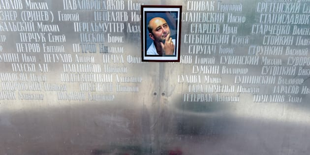 Flowers lie under a picture of 41-year-old anti-Kremlin reporter Arkady Babchenko on the memorial wall of Moscow's journalists house in Moscow on May 30 2018. The prominent Russian war correspondent and former soldier was shot dead on May 29 in an apparent contract-style killing in the stairwell of his building in Kyiv.