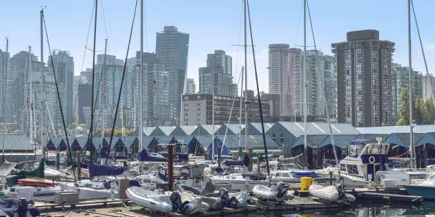 Condo and apartment towers in Vancouver's West End are seen from a marina. The city's housing market has recorded its slowest year since 2000.