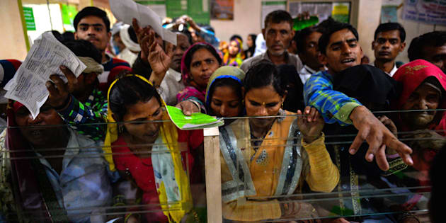 In this photograph taken on November 16, 2016, Indian villagers wait inside the bank to make the transactions in Basendua village in Bulandshahr, in northern Uttar Pradesh state.
