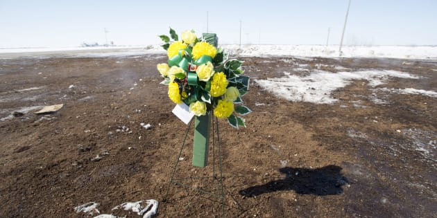 Flowers laid by RCMP officers sit at the intersection of a crash site near Tisdale, Sask. on April, 8, 2018.
