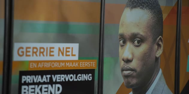 A poster with Duduzane Zuma's face is seen during AfriForum's media briefing to announce they will be privately prosecuting him on October 17, 2017, in Pretoria, South Africa.