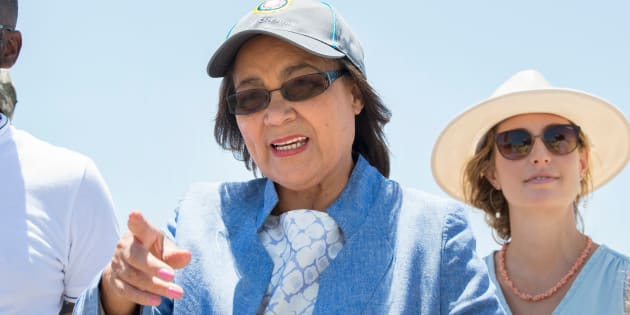 Cape Town City Mayor Patricia de Lille (C) talks to media at a site where the city council has ordered drilling into the aquifer to tap water, in Mitchells Plain, about 25km from the city centre on January 11, 2018 in Cape Town.