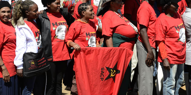 Supporters of the South African Communist Party (SACP), wearing t-shirts of the late anti-apartheid activist Chris Hani attend the 20th anniversary of the assassination of Chris Hani  on April 10, 2013 at the Thomas Titus Nkombi Memorial Park in Elspark.