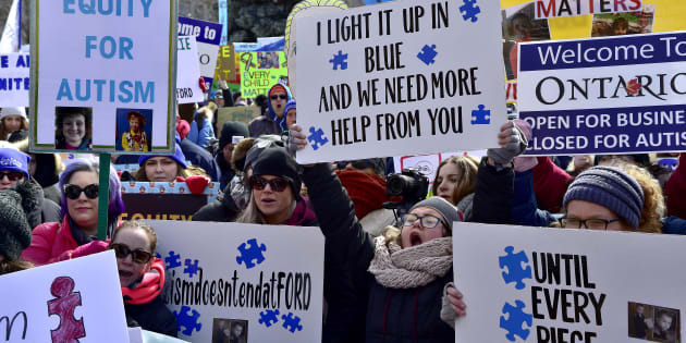 Hundreds of parents and supporters gather outside Queen's Park in Toronto on March 7, 2019, to protest the Ontario government's changes to its autism program.