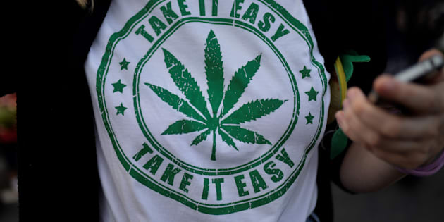 A woman wears a t-shirt featuring a cannabis leaf at the marijuana march in Ipanema, Rio de Janeiro, Brazil, May 6, 2017. On October 17, Quebecers will be able to light a joint legally — but it appears they will lose the right to buy T-shirts or posters with the marijuana leaf on them.