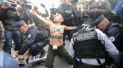 Des militantes Femen interpellées près du bureau de vote de Marine Le