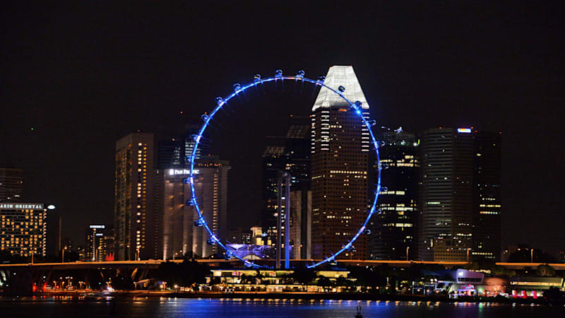 the-singapore-flyer-is-seen-illuminated-before-the-countdown-for-the-picture-id657634834
