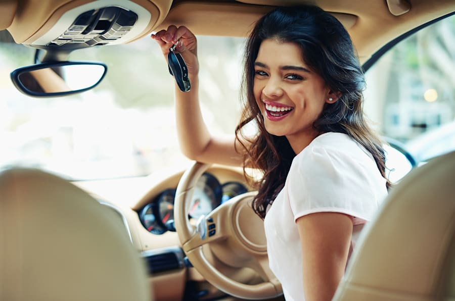 Shot of an attractive young woman excited about her new car