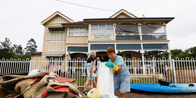 Residents help to clean up the Lismore Medical clinic after the floods