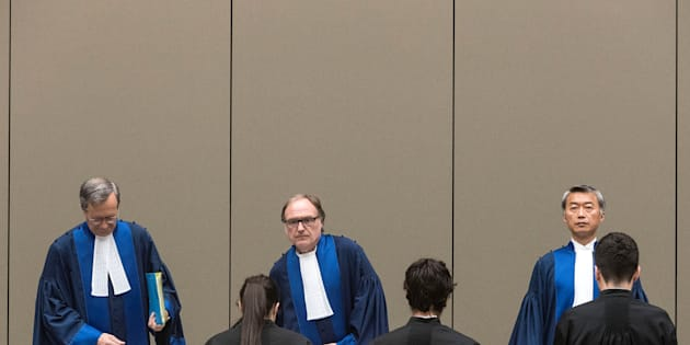 Judge Cuno Tarfusser (C), Judge Chang-ho Chung (R) and Judge Marc Perrin de Brichambautat (L) issue a ruling on South Africa's failure to arrest Sudanese President Omar al-Bashir during a three-day visit in June 2015, during a session of the International Criminal Court in The Hague, Netherlands, July 6, 2017.