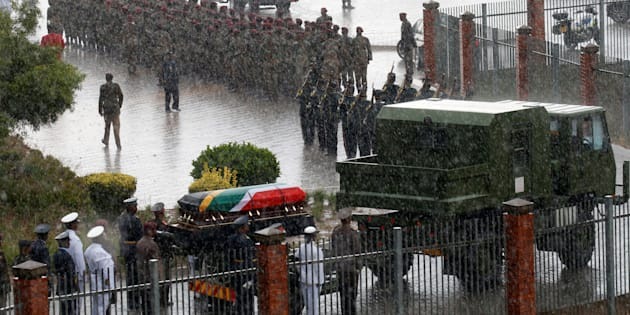 Winnie Madikizela-Mandela's coffin is taken from the Orlando stadium in the pouring rain during her funeral service in Soweto, South Africa April 14, 2018.