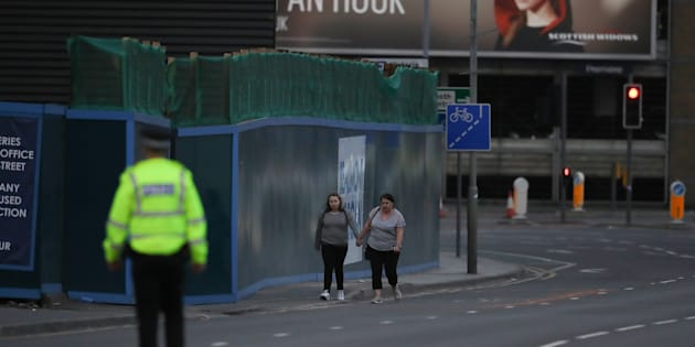 MANCHESTER, ENGLAND - MAY 23: Ariana Grande concert attendees Vikki Baker and her daughter Charlotte, aged 13, leave the Park Inn where they were given refuge after last night's explosion at Manchester Arena. (Photo by Christopher Furlong/Getty Images)