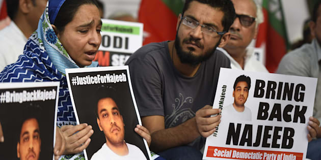 Najeeb Ahmad's mother with members of SDPI stages a protest to demand justice for  her son.