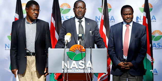 Kenyan opposition leader Raila Odinga (centre), the presidential candidate of the National Super Alliance coalition, his running mate Kalonzo Musyoka (right) and Moses Wetangula at a press conference in Nairobi in September 2017.