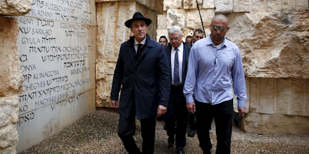"""Head of the Austrian Freedom Party (FPOe) Heinz-Christian Strache (L) visits """"The Valley of the Communities"""" monument which bears engravings with the names of some 5000 Jewish communities destroyed by the Nazis or their collaborators at Yad Vashem's Holocaust History Museum in Jerusalem, April 12, 2016. REUTERS/Ronen Zvulun"""
