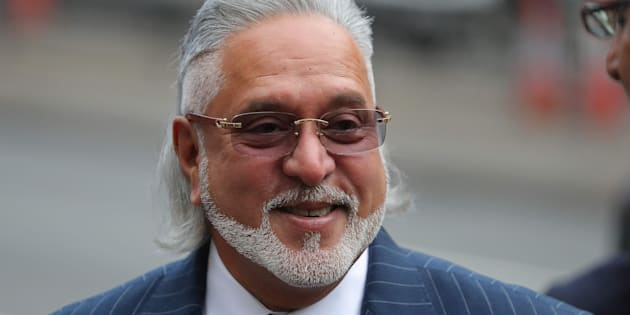 Indian tycoon Vijay Mallya reacts as he waits to re-enter Westminster Magistrates Court in central London on December 4, 2017, for the start of his extradition hearing.