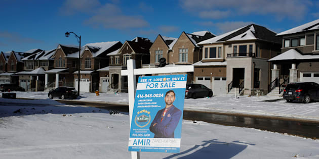A house for sale in East Gwillimbury, Ont., Jan. 30. 2018. A new report from CIBC says the correction in Canada's housing market is not over yet — though it might finally come to an end next year.