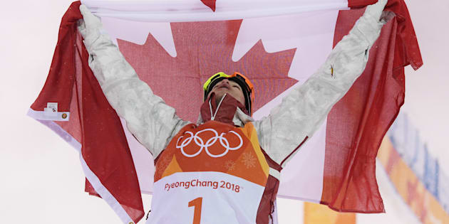 Canada's Mikael Kingsbury of Canada celebrates winning gold in the men's moguls.