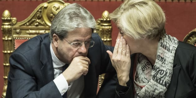 ROME, ITALY - DECEMBER 14: Italian Prime Minister Paolo Gentiloni and Minister of Defense Roberta Pinotti  talk during a confidence vote at the Italian Senate on December 14, 2016 in Rome, Italy. (Photo by Alessandra Benedetti - Corbis/Corbis via Getty Images)