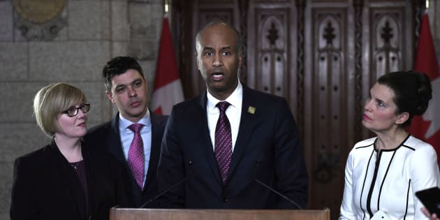 Immigration Minister Ahmed Hussen makes an announcement on medical inadmissibility as Public Services Minister Carla Qualtrough, Liberal MP Serge Cormier, and Persons With Disabilities Minister Kirsty Duncan look on, in the foyer of the House of Commons on April 16, 2018.