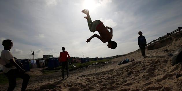 Youths somersault in Khayelitsha township, near Cape Town.