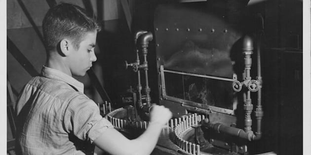 A young boy working in a war factory 1940-45.