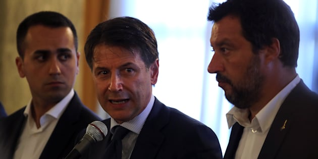 Italian Prime Minister Giuseppe Conte speaks as he is flanked by Interior Minister Matteo Salvini and Minister of Labor and Industry Luigi Di Maio during a media conference at the prefecture in the Italian port city of Genoa, Italy August 15, 2018. REUTERS/Stefano Rellandini