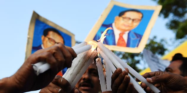 REPRESENTATIONAL IMAGE. Indian activists hold candles and portraits of 20th century Indian social reformer B. R. Ambedkar as they take part in a protest against a Supreme Court order that allegedly diluted the Scheduled Castes and Scheduled Tribes (Prevention of Atrocities) Act in Kolkata on April 4, 2018.