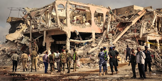 EDITORS NOTE: Graphic content/Somali security officers patrol on the scene of the explosion of a truck bomb in the centre of Mogadishu, on October 15, 2017.