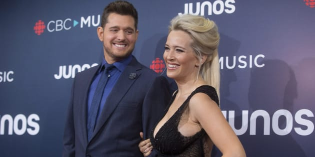 Michael Buble and wife Luisana Lopilato arrive on the red carpet at the Juno Awards in Vancouver, Sunday.